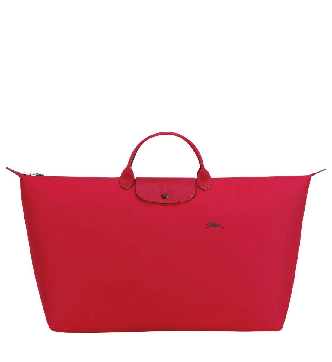 Sac de voyage XL Le Pliage Club en toile de nylon et détails en cuir, Longchamp, 100€ au lieu de 125€.